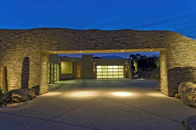 Picture of concrete driveway with lighted garage entryway